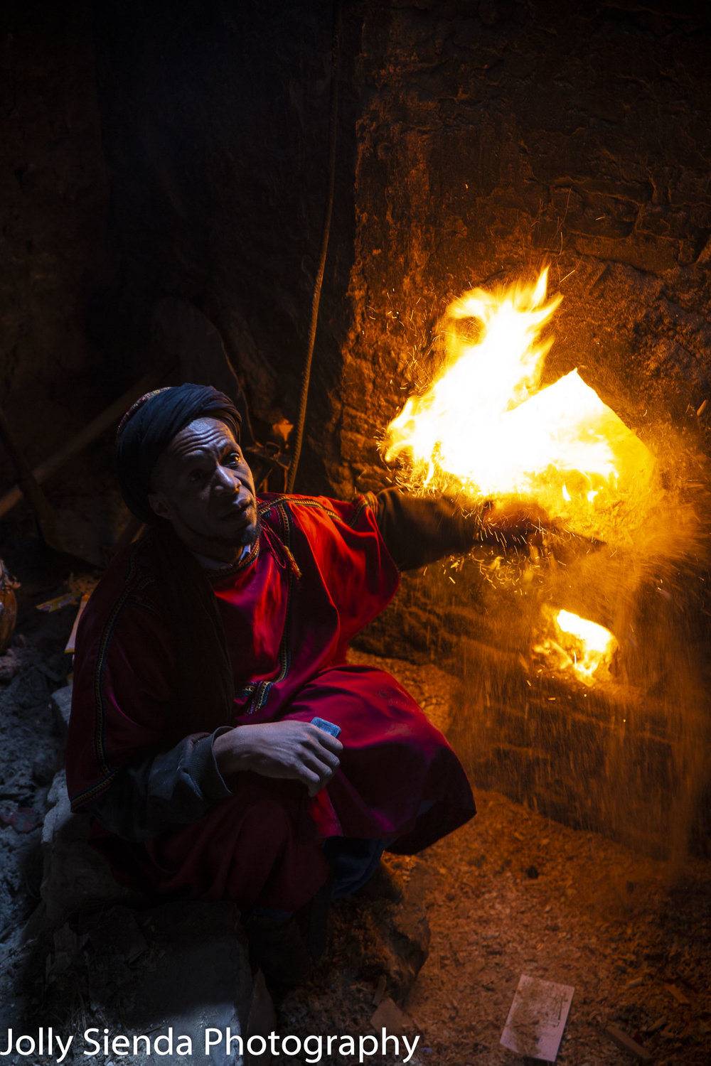 Man feeds the fire at the Hamman