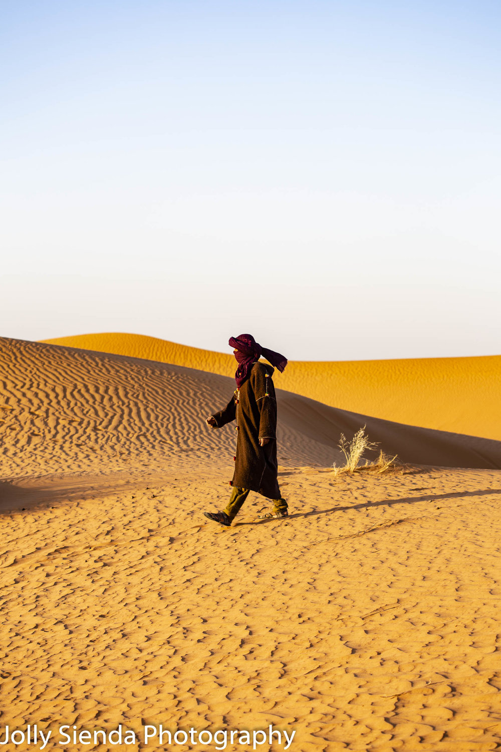 Camel herder walks the dunes at Erg Chebbi
