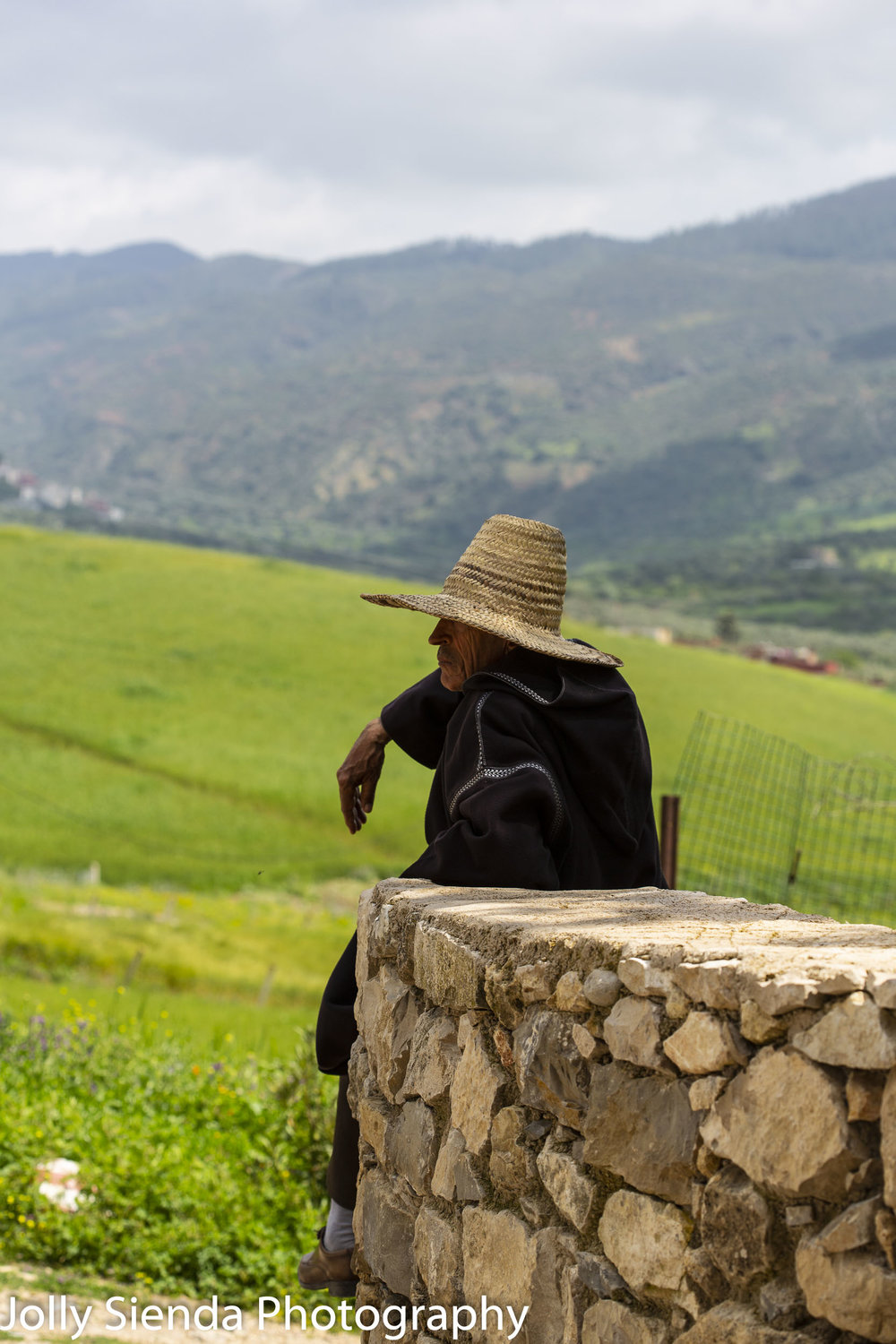Shepherd wears a straw hat and rests