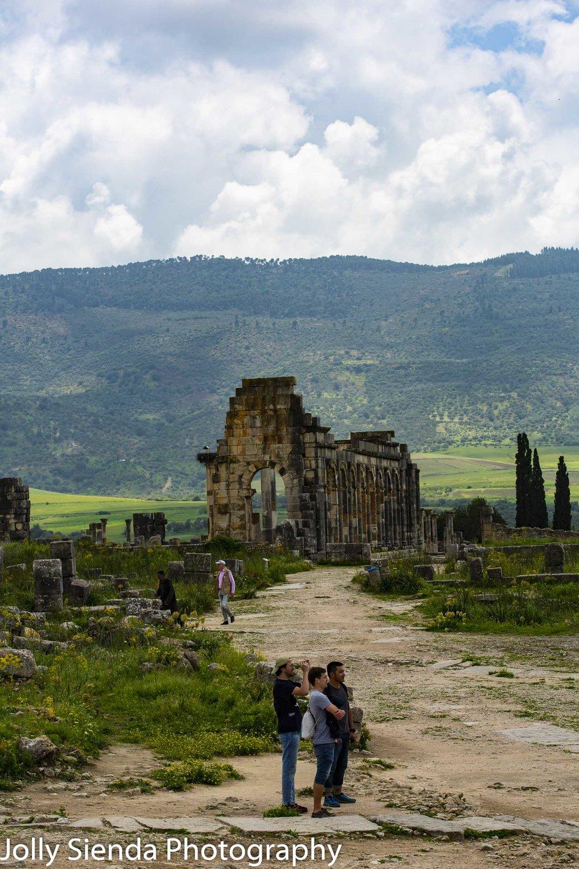 Tourists explore Volubilis