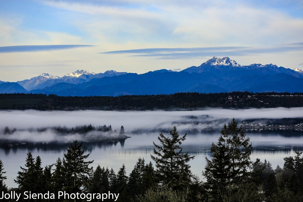 Autumn fog over Dyes Inlet and the Olympic Mountains