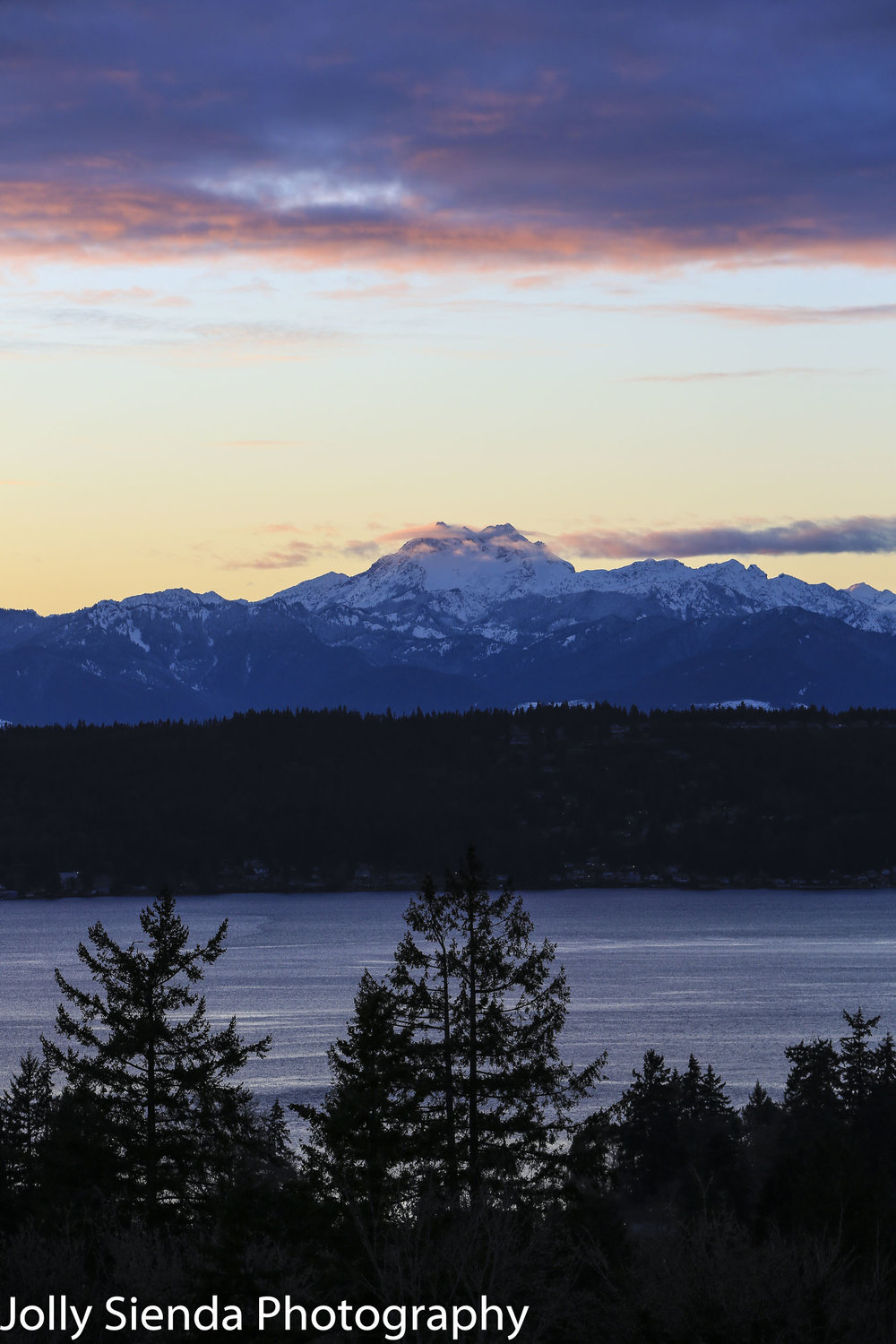 Pastel magenta sunset over the snow capped Brothers Mountain and