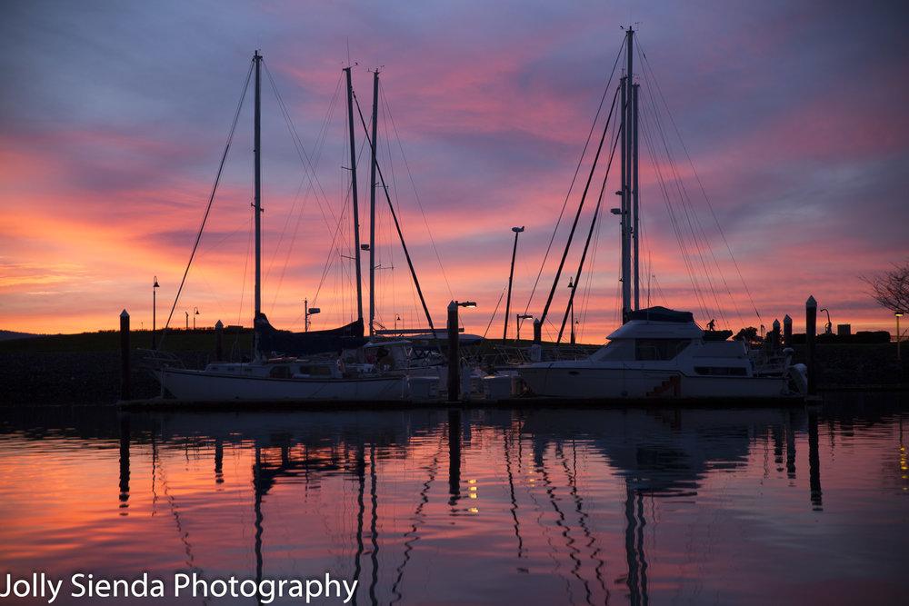 Pink sunset on boat marina