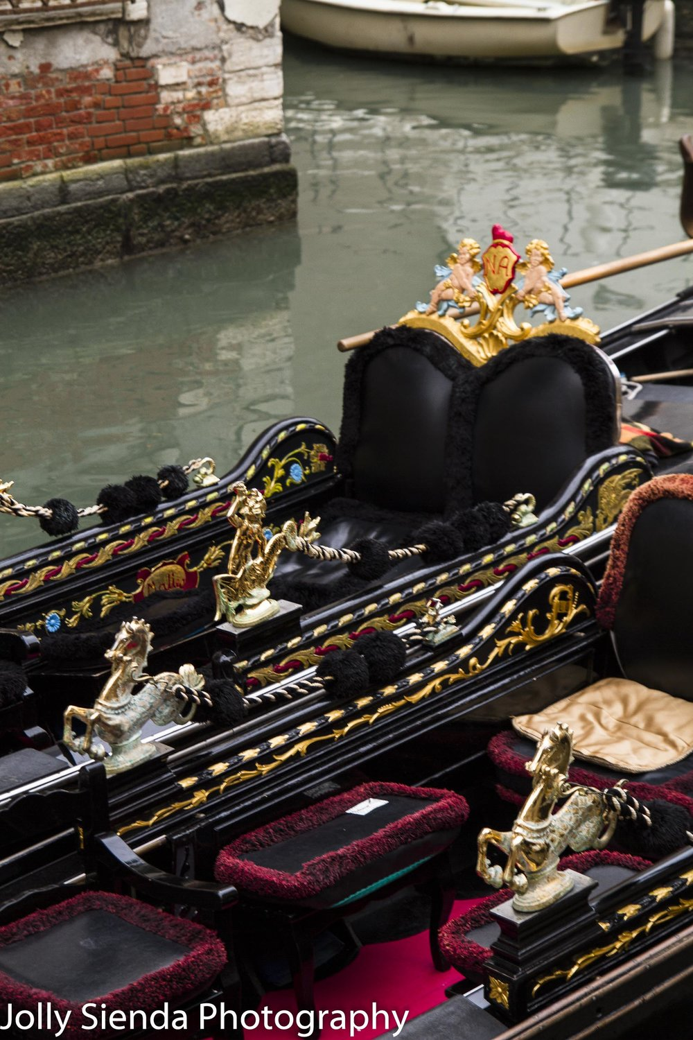 Artistic gondola interiors with golden seahorses and lovers cres