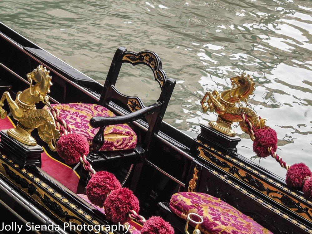 Gondola interior adorned with a golden horse serpent,  velveteen