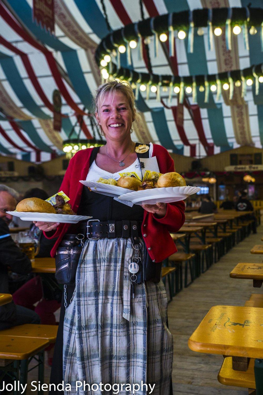 Fraulein waitress brings the schnitzel