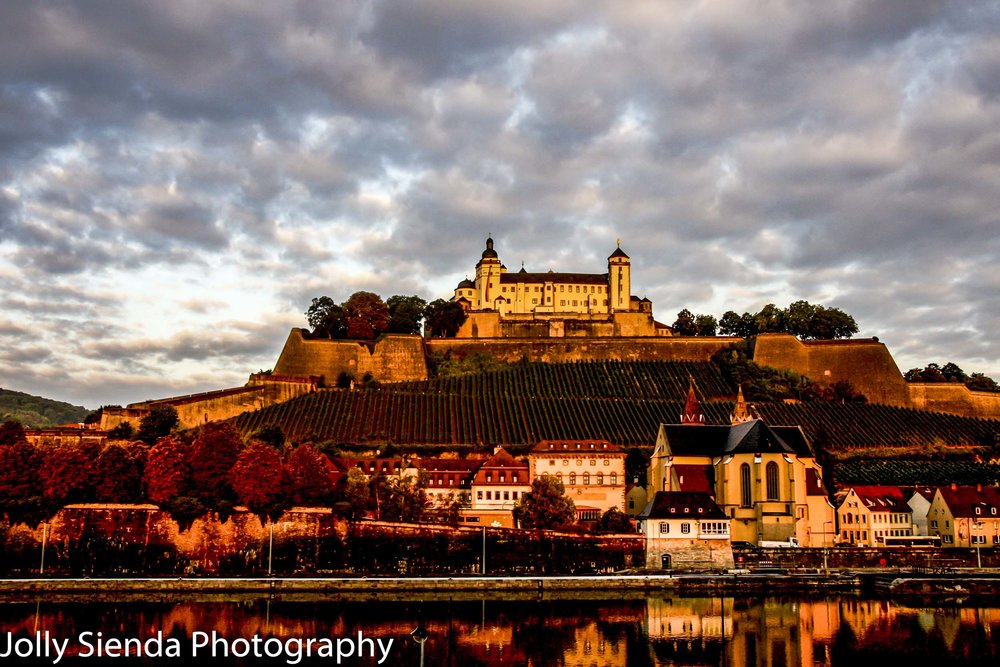 Fortress Marienburg basks in the sunset of Autumn colors with ne