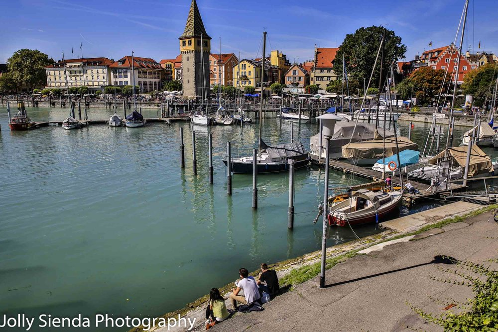 Lindau am Bodensee marina, boats, and people sitting on the bank
