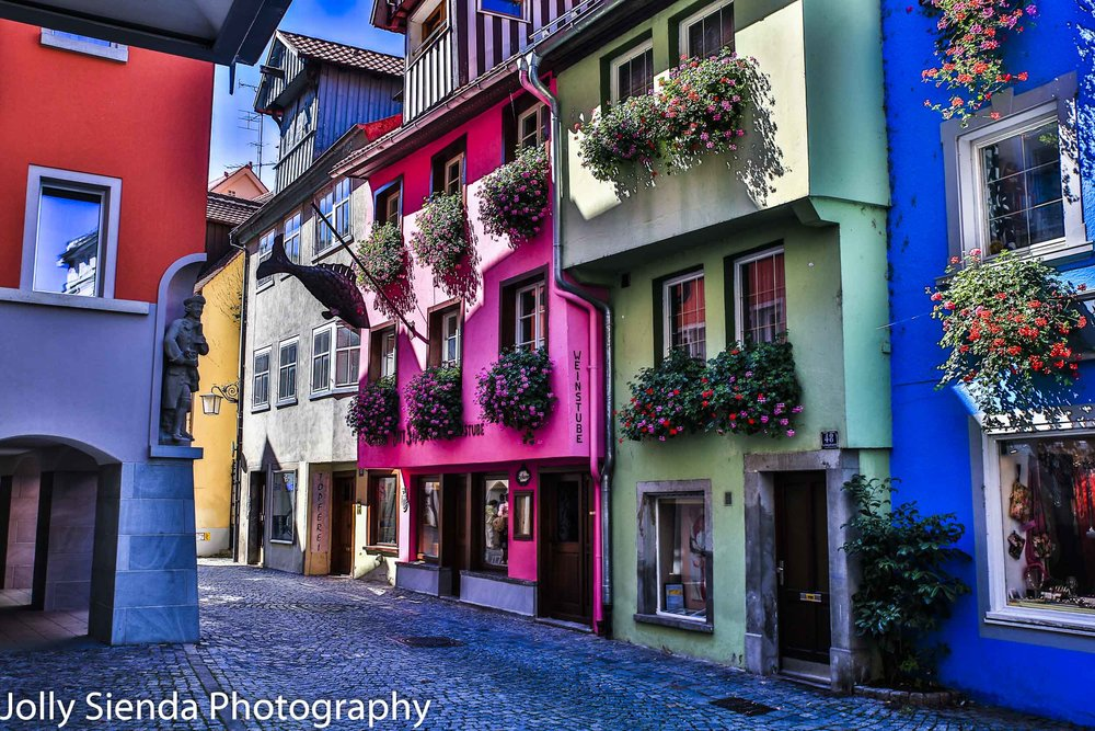 Pastel colored painted village with blooming flower window boxes