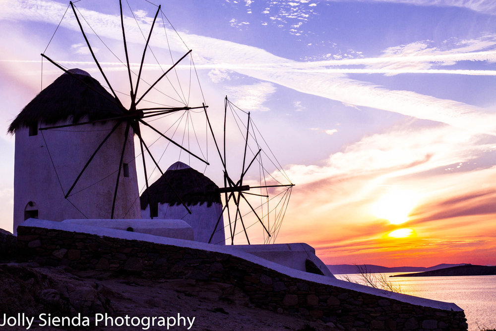 Two Windmills bask in golden pink sunset