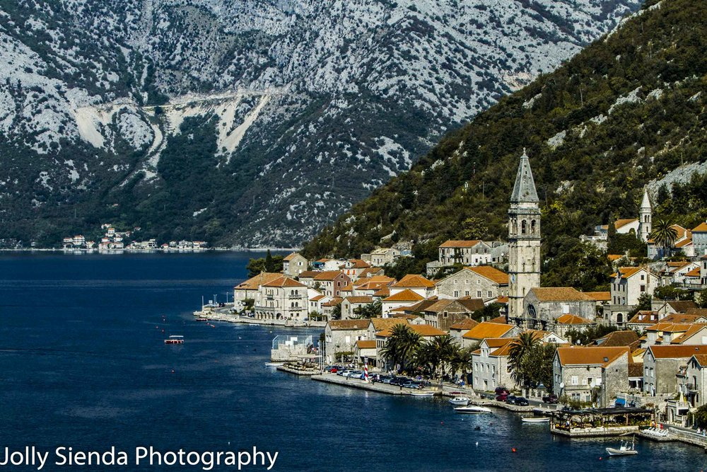 Orange tiled roofs, church and a village waterfront, Tivat, East