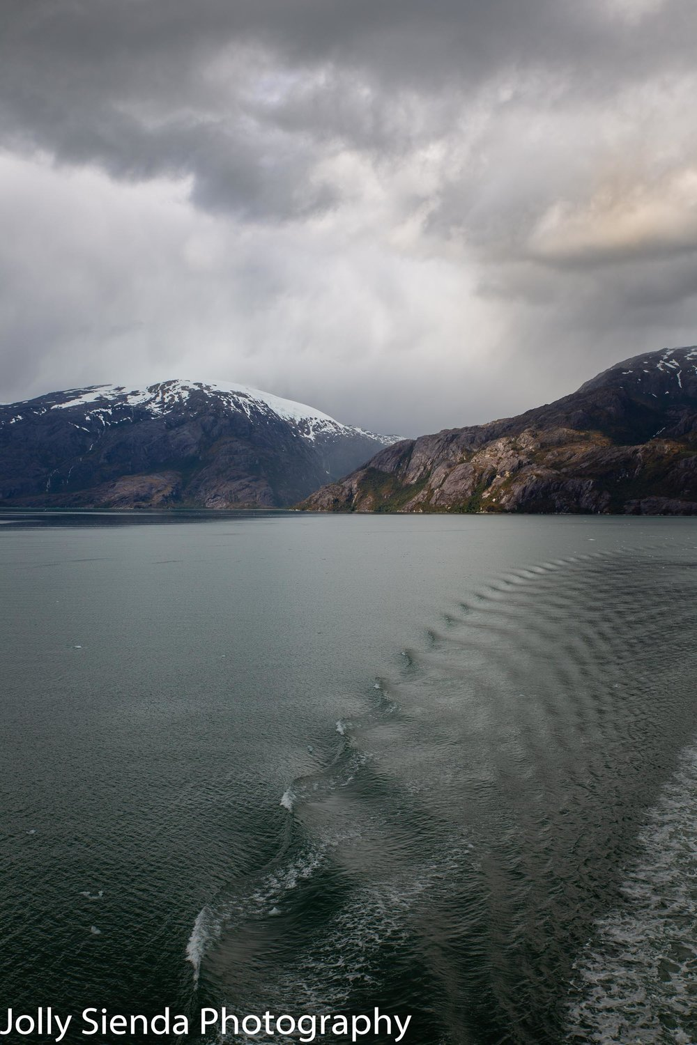 Long water ripple and the snow capped Chilean Fjords