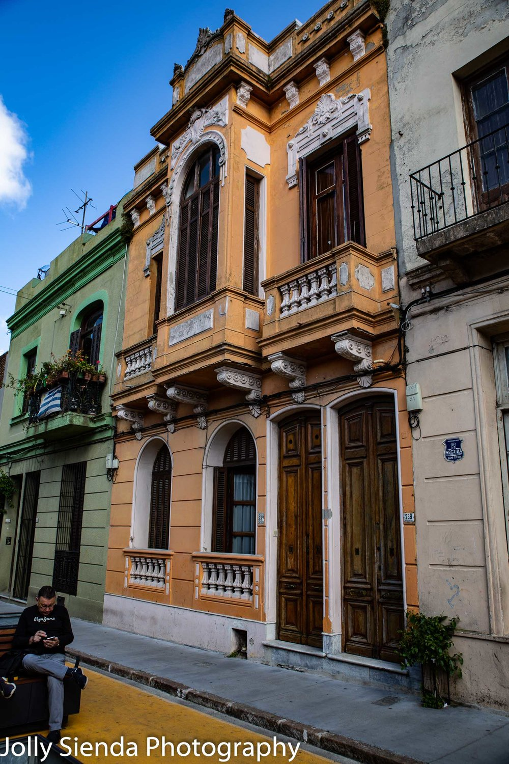 Colonial Spanish architecture, blanconies, and a man checking hi