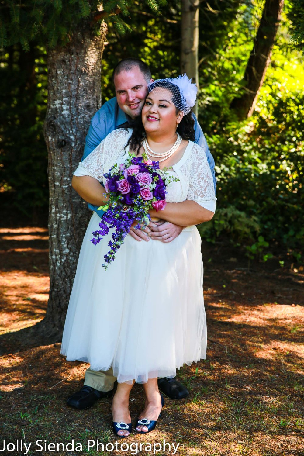 Sweet outdoor wedding photography with the bridal couple
