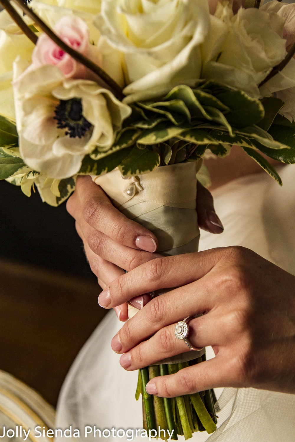 Bridal bouquet and the diamond engagement ring