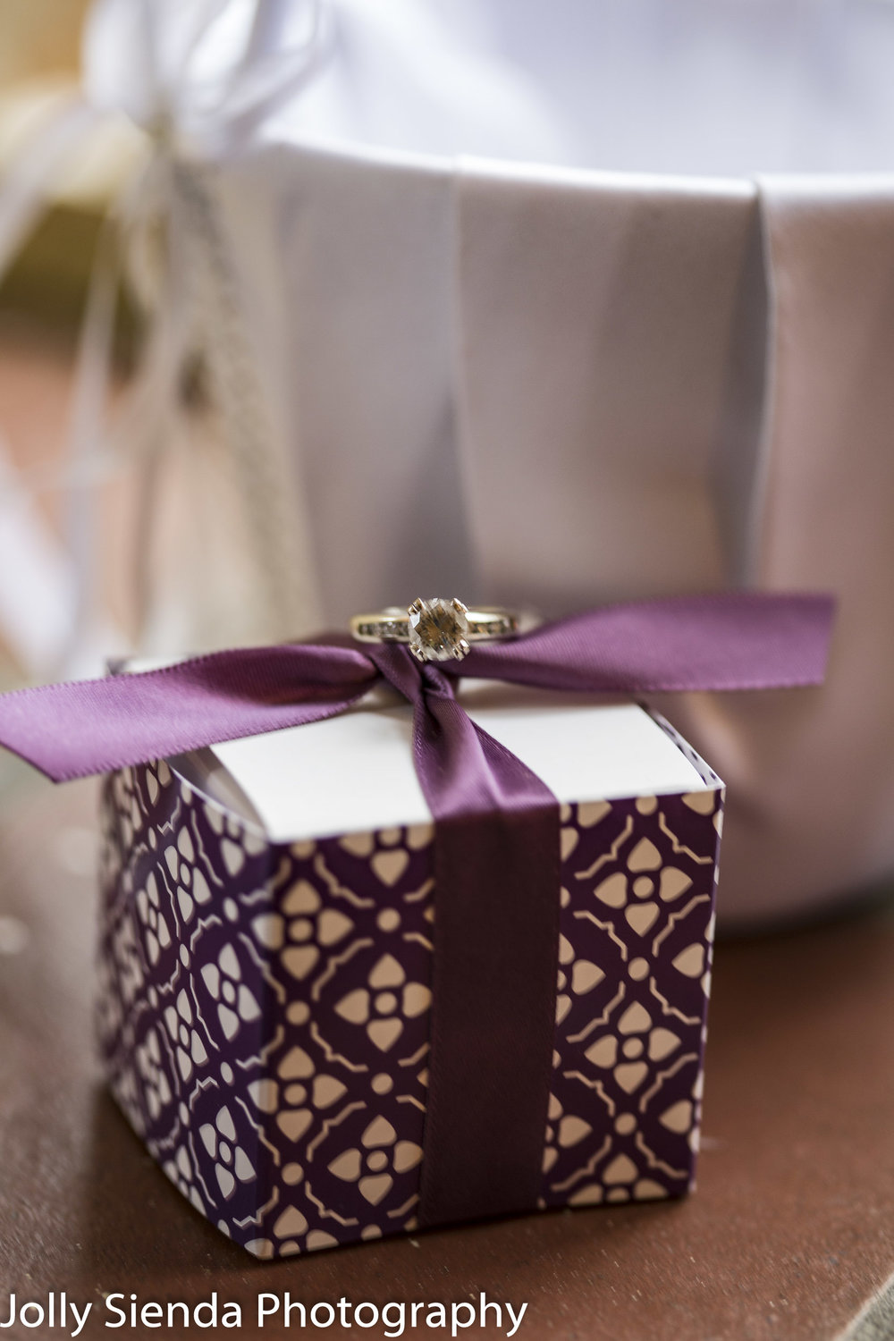 Diamond wedding ring on a wrapped package