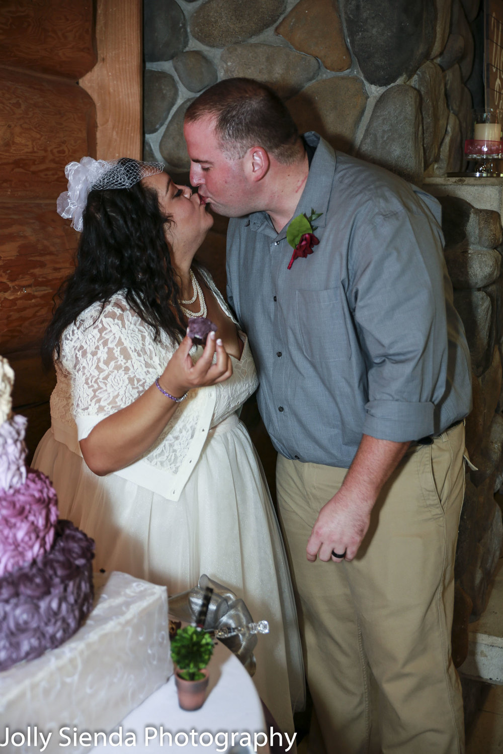 Nieves and Chad kiss while eating wedding cupcakes