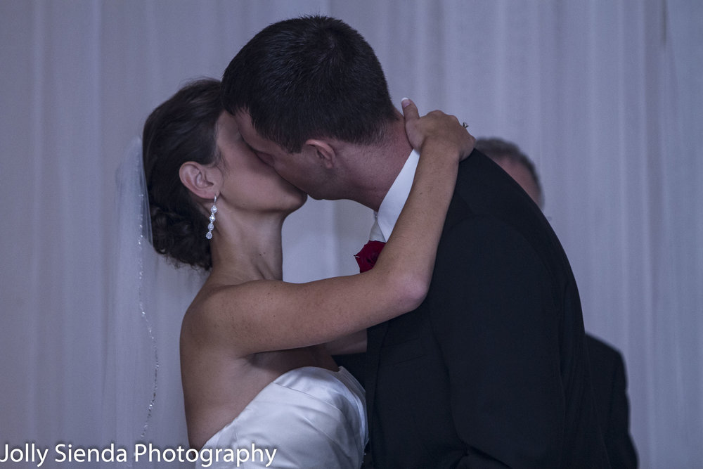 The bride and groom share their first kiss as man and wife at their wedding ceremony.