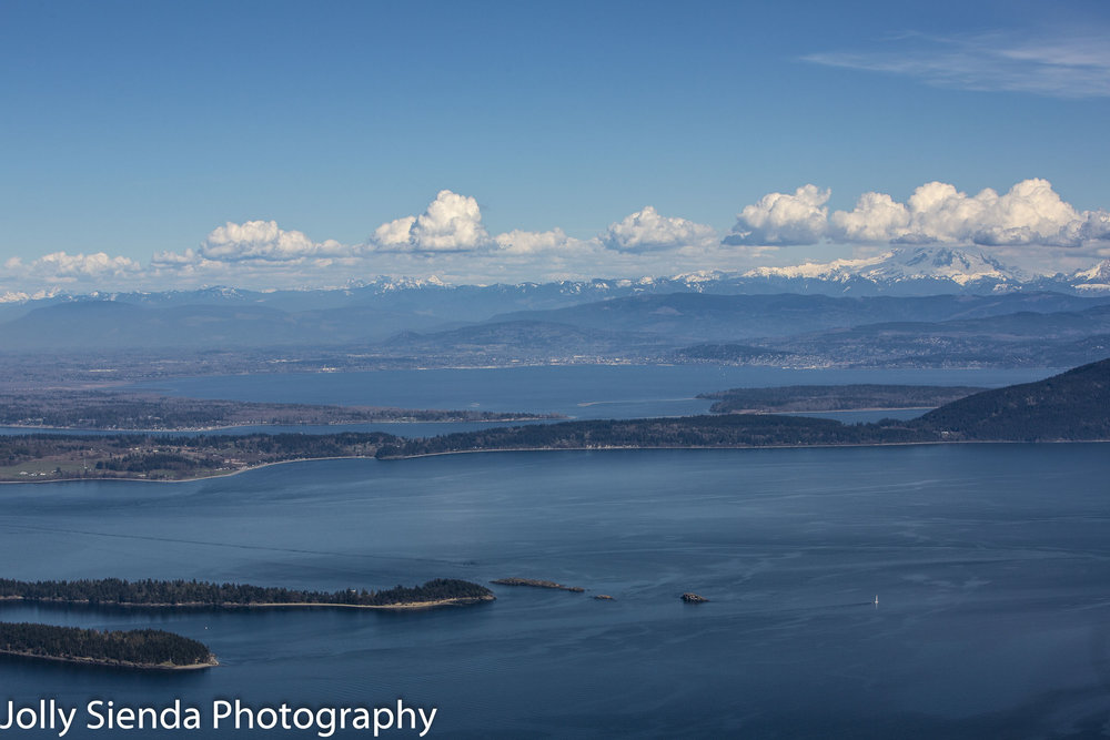 Aerial views of the San Juan Island archipelago and the Cascade Mountains from Mount Constitution summit.