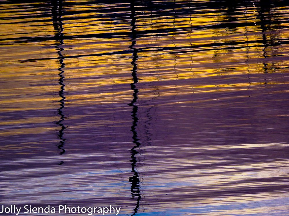 Painted Rippled Sunset and Sailboat Masts