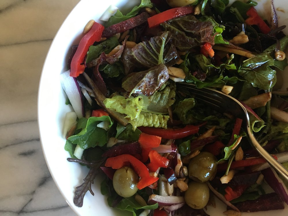 Add red pepper, pickled garden beets, fennel, red onion, sunflower seeds and green olives.