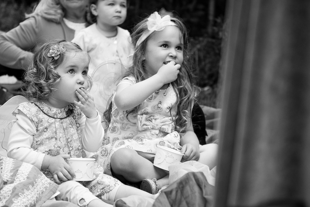 Girls watching puppet show - Mountain View Birthday Party Photography