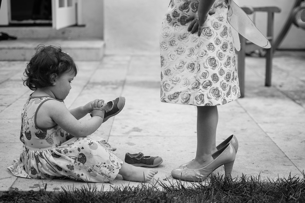 Girl helping child put shoes on - Mountain View Family and Birthday Party Photography