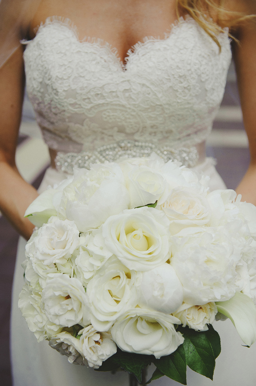 Stunning all white bridal bouquet with roses and trumpet lilies by Yellow Canary Floral & Event Design