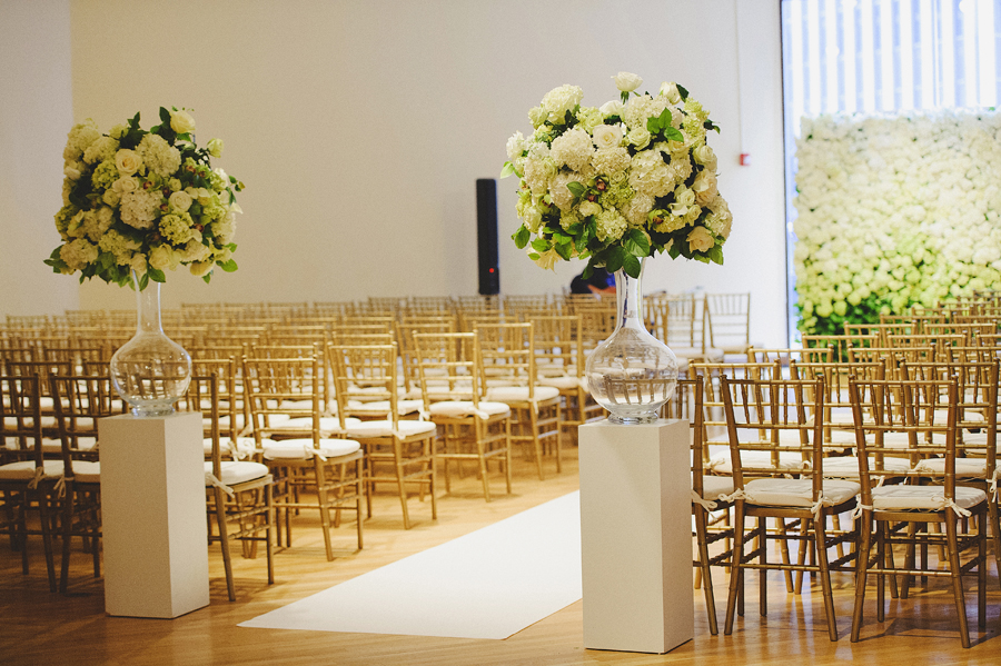 White and green flower wall for wedding ceremony by Yellow Canary Floral & Event Design
