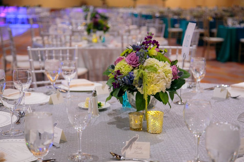 Floral arrangement with roses and hydrangea for masquerade gala by Yellow Canary Floral & Event Design