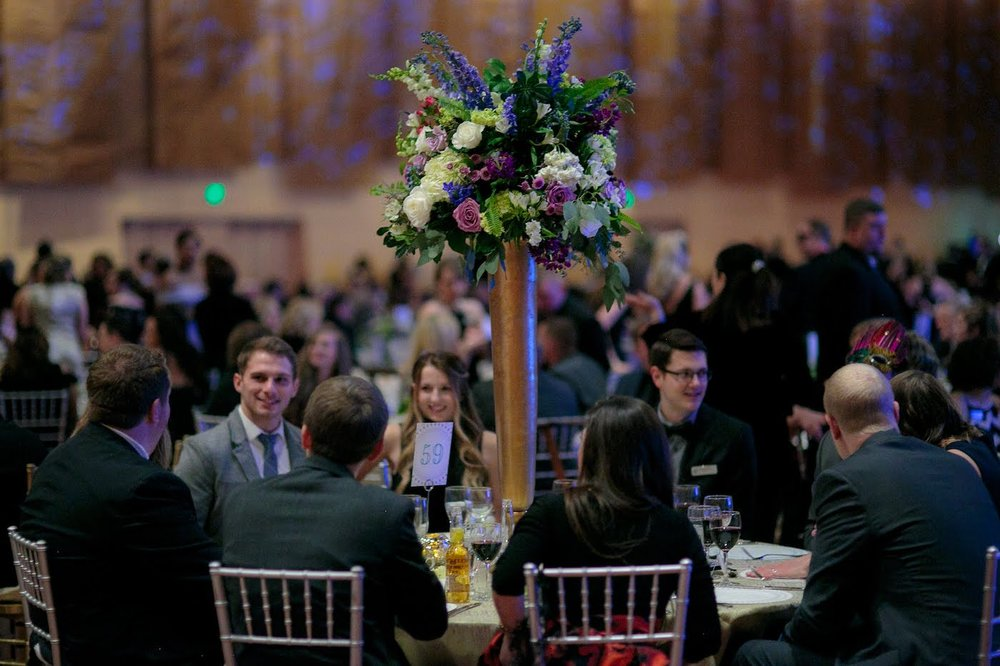 Floral arrangements by Yellow Canary Floral & Event Design with rose, hydrangea and dusty miller for Health Carousel Gala