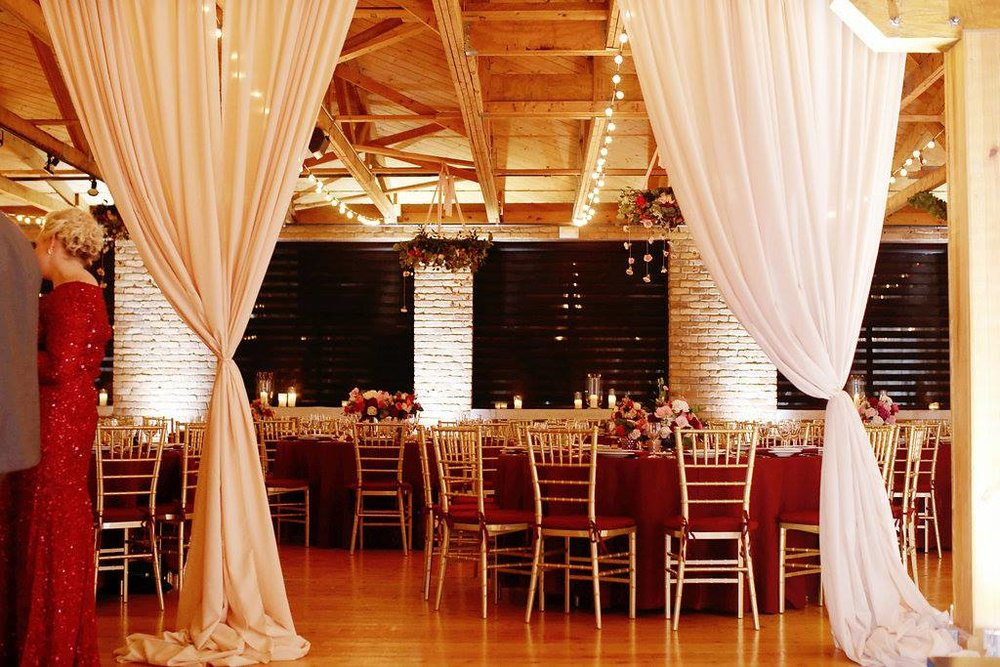Blush and burgundy winter wedding at Cincinnati's Rhinegeist Brewery. Florals by Yellow Canary. www.yellowcanaryonline.com