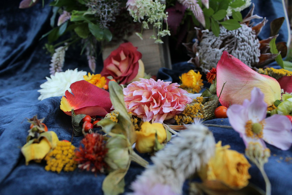 Fall floral arrangement in rustic wood box with dahlias and local foraged plants by Yellow Canary. www.yellowcanaryonline.com