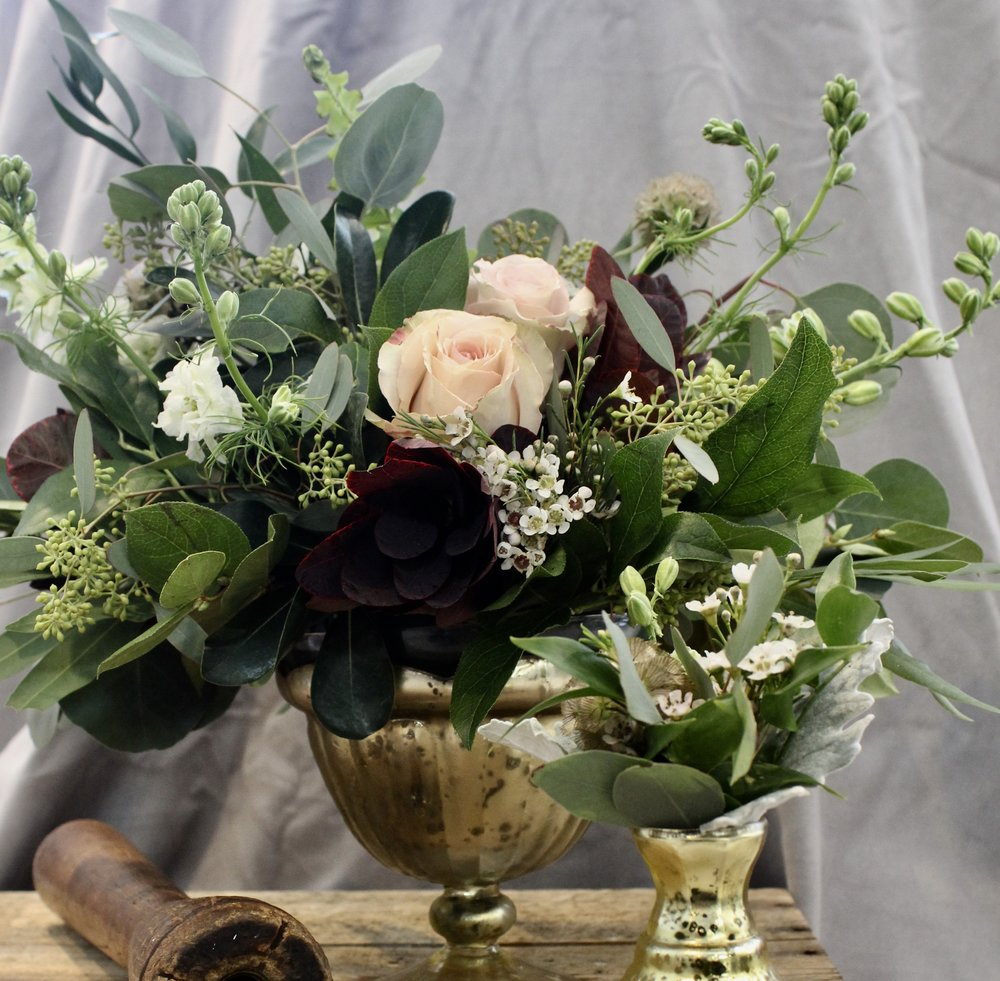 Roses and lots of green foliage in gold vessels for fall wedding in Cincinnati. Floral arrangement by Yellow Canary. www.yellowcanaryonline.com