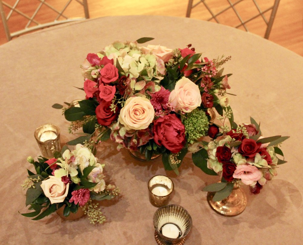 Winter wedding reception florals by Yellow Canary