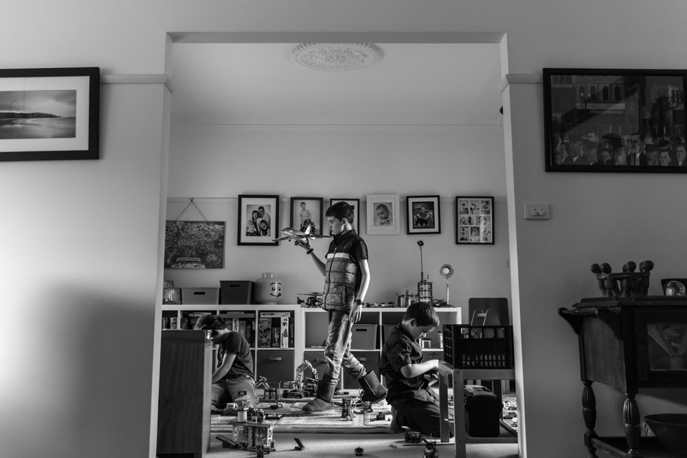 Three boys in their toy room playing with toy planes during a Geelong family photo session