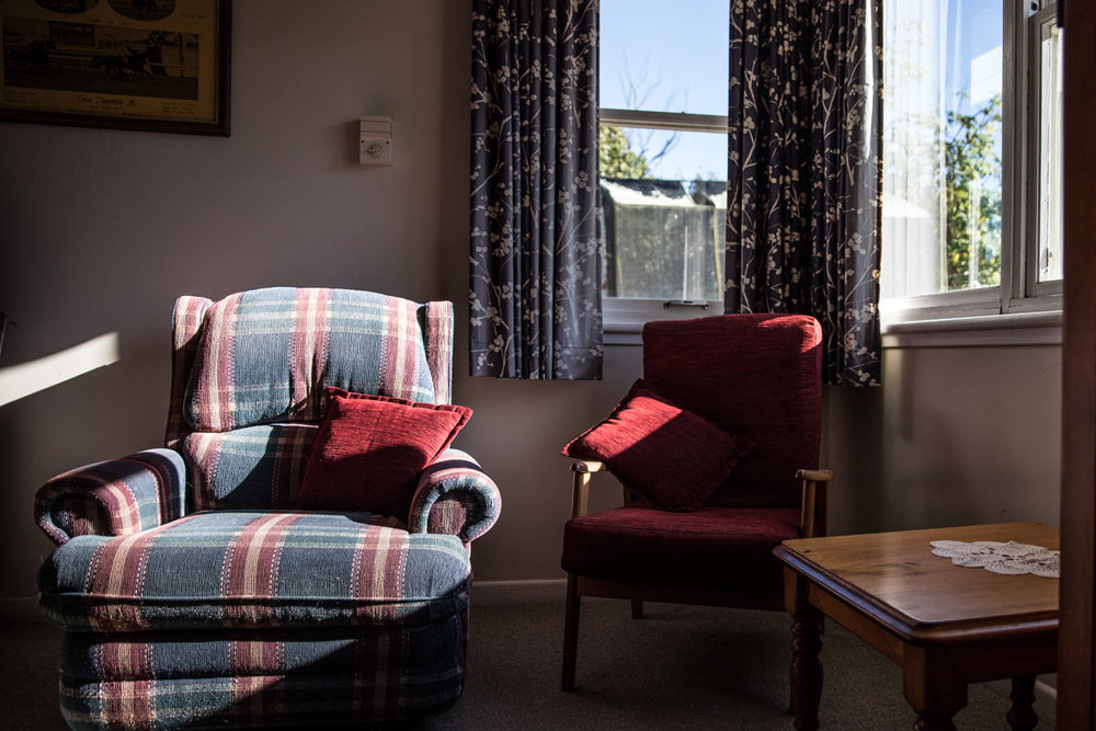 two arm chairs in the sunlight in old Geelong home