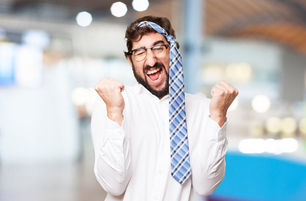 man celebrating with his tie on his head.jpg