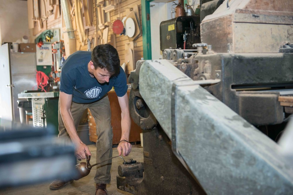 Since our arrival in 1856, - the monks and craftsmen of Saint John's Abbey have utilized local resources for their buildings and furniture. Walk anywhere on campus and you'll soon recognize the distinctive furniture that has comes from Abbey Woodworking.Today, we honor this 150 year tradition of woodworking at Saint John's by continuing to use our hands and local resources as a witness to the values of manual labor, sustainability and an honest use of materials. But more than a witness, we seek to continue mentoring others who wish to understand the art and techniques of woodworking through student work,apprenticeship and volunteer opportunities.