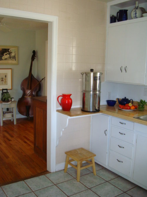 from kitchen door west wall into dining area (that we don't use ).JPG