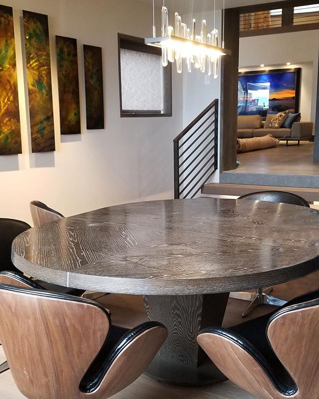 This custom, oval, wood veneer table designed by Solanna Custom Furniture sits just outside our Gym/Yoga Room at our Tahoe project, welcoming guests to sit and relax after a workout. #solannadesign