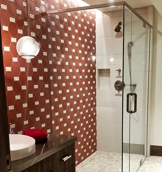 The kids bathroom gets a fun burst of red and white with @kazaconcrete tiles and @varaluz pendant that balances this art deco style with modern, clean curves. #solannadesign