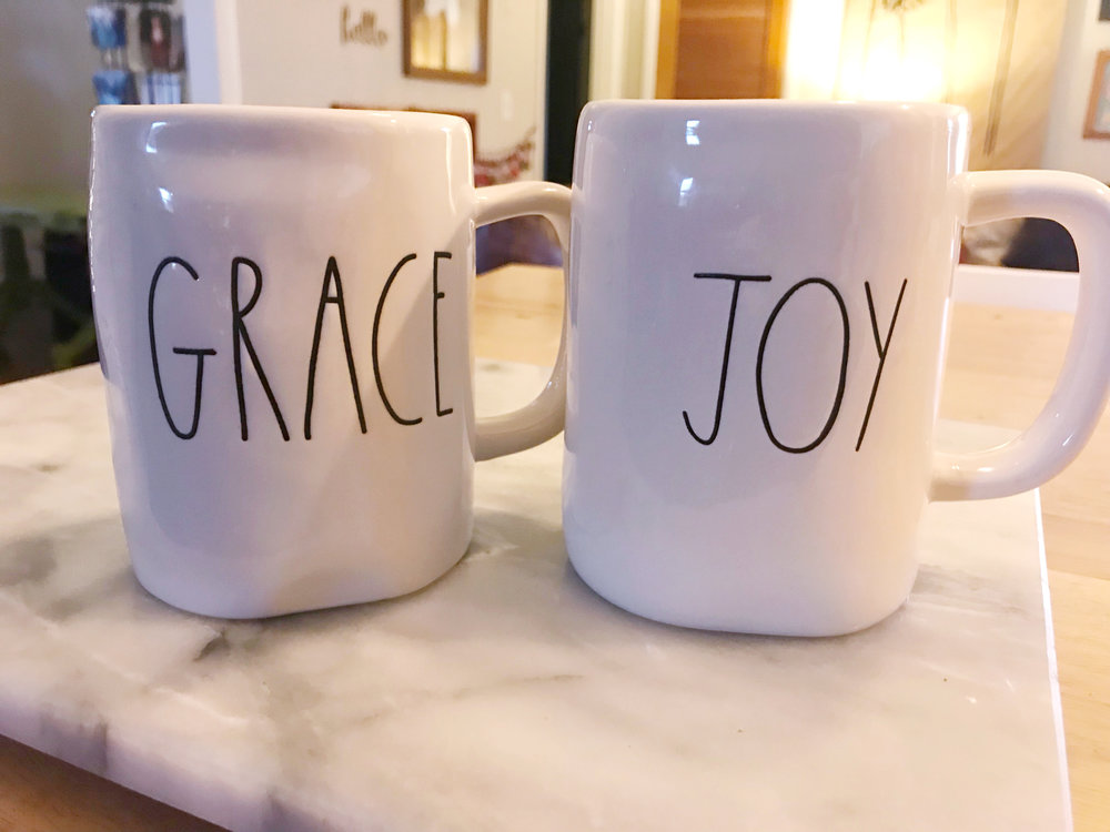 Jen surprised Courtney with these sweet Rae Dunn mugs that have their family's words of 2018!
