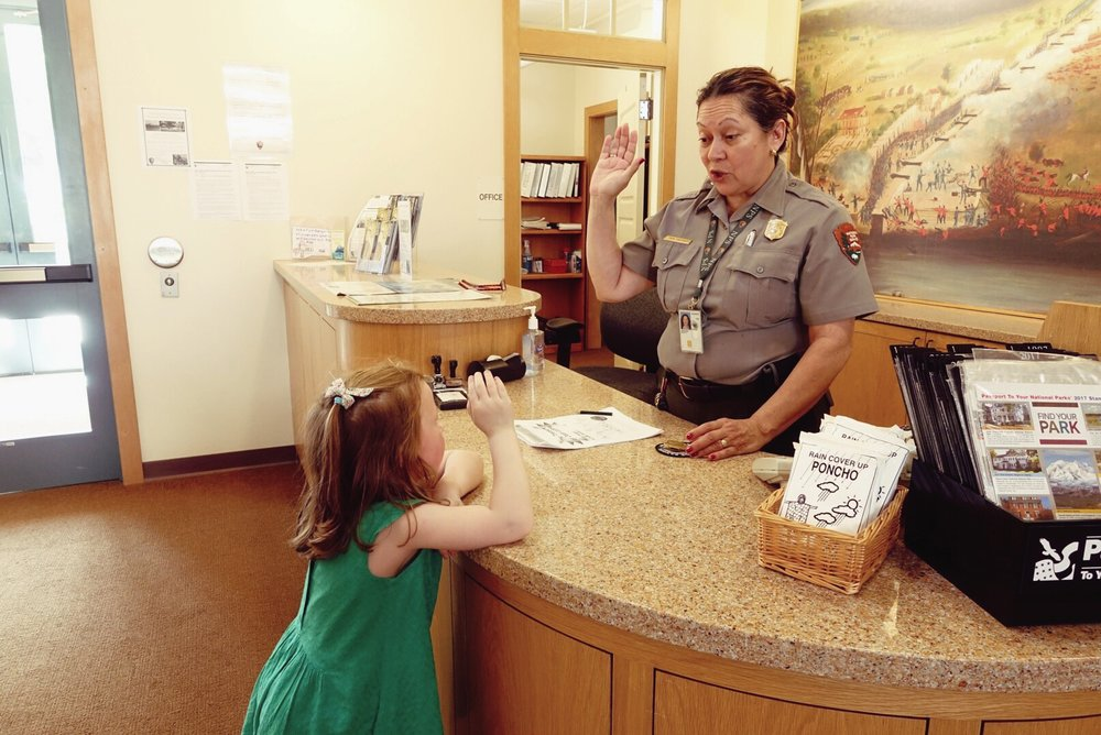 "Mattie Grace getting ""sworn in"" as a Junior Ranger at one of our National Park visits. They have great programs for children of all ages!"