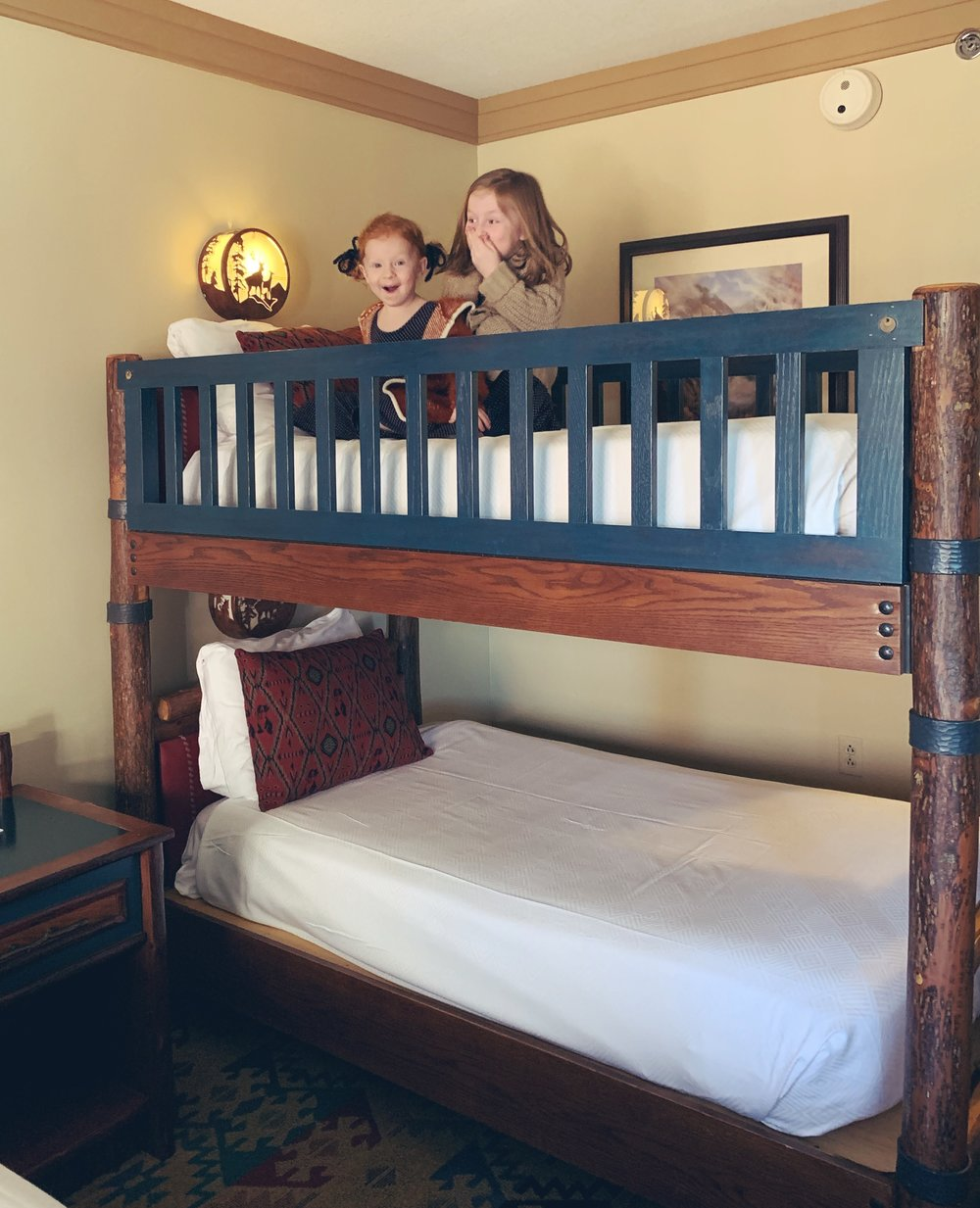 Courtney's girls with their upgraded bunkbed at Disney's Wilderness Lodge - they were so happy!