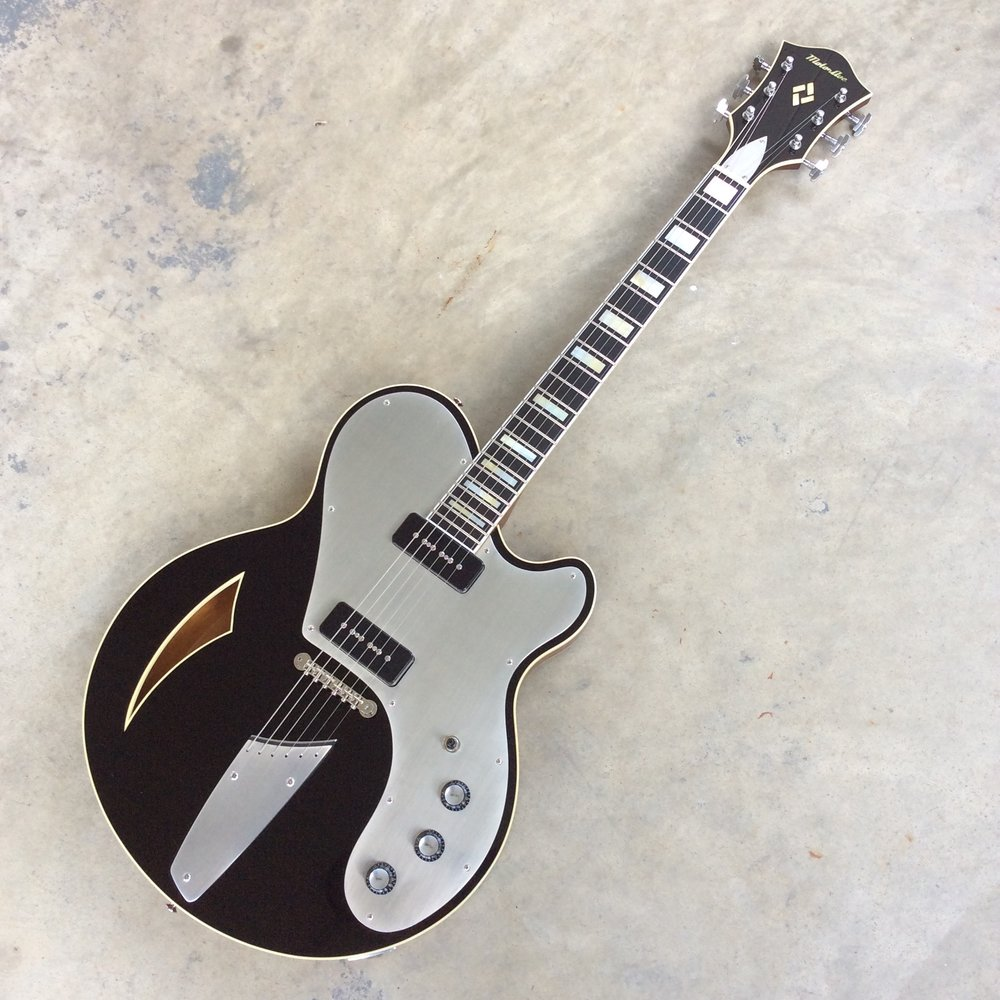 Priced with options above (block inlays, aluminum pickguard, and a string-thru tailpiece): $6000