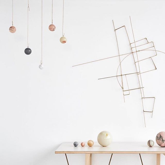 G A L A X Y / globe . A collection of elegant mobiles made from light brass rings that slowly move around each other with a marble center, resembling a small solar system 💫🌚🌕 . By Danish architect @kaja_skytte via @formland_official . #objectsofdesire #interiorstyling @beckswolski
