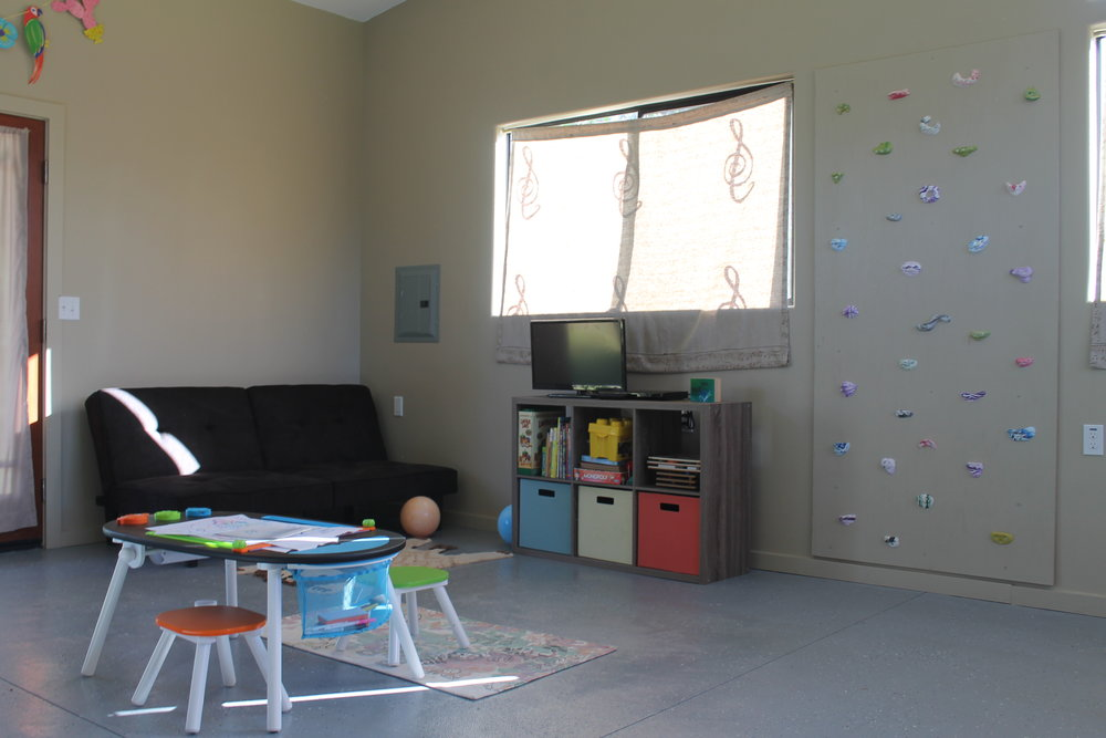Recreation Room - The recreation room offers entertainment for children both big and small. The large room includes a children's art center, books, games, toys, and an-indoor climbing wall. Parents can enjoy the built-in bar, exercise accessories or relax while the children play.