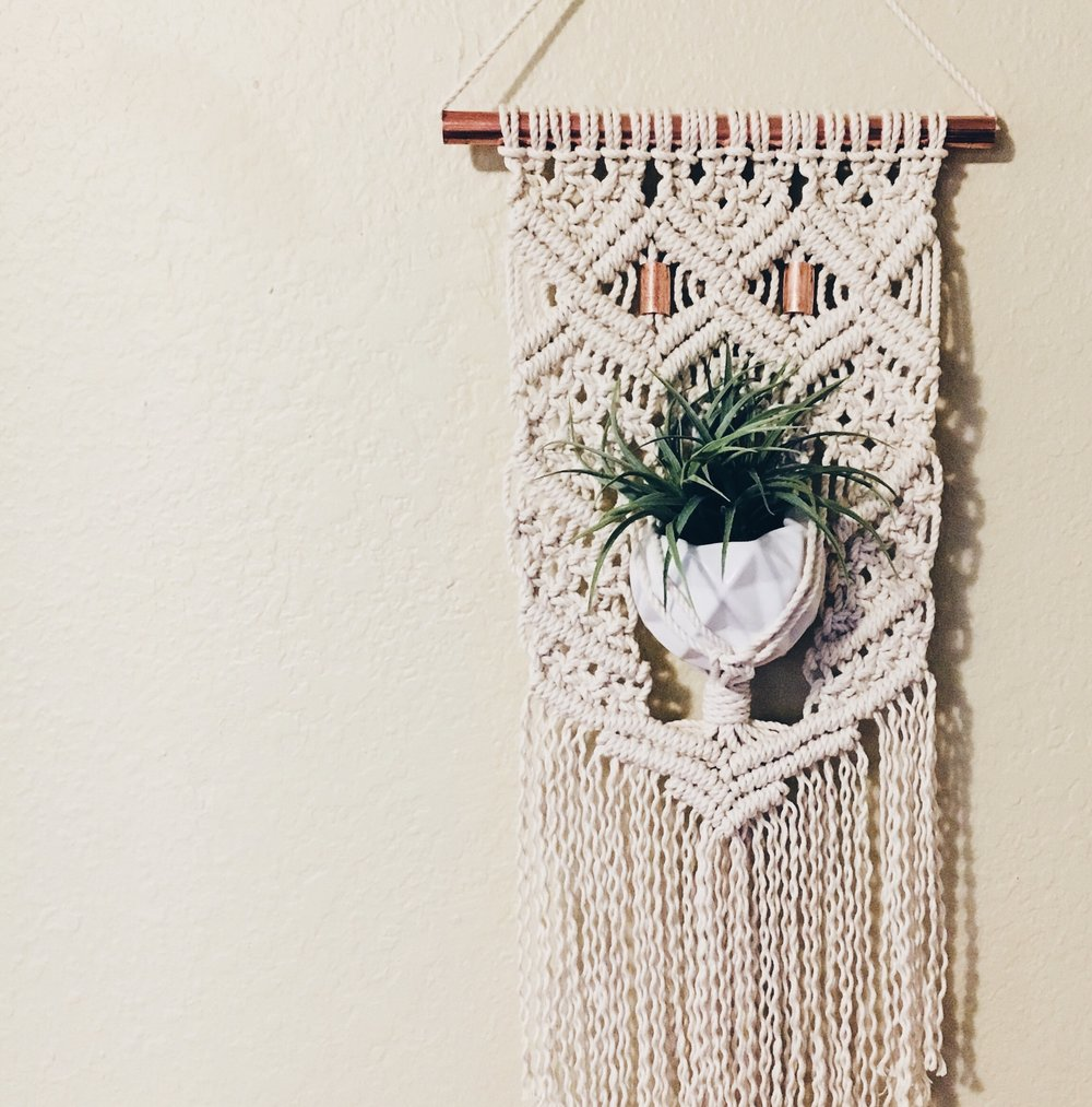 """Pictured: 12"""" wide custom wall hanging (with plant hanger) on a copper rod with copper accents. $80"""