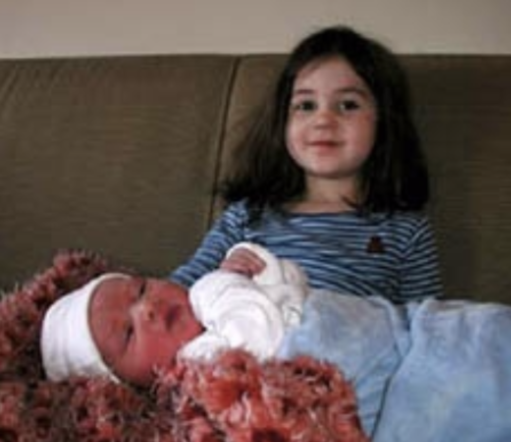 Proud big sister Louise holds new­-born Roland Henry McCarter
